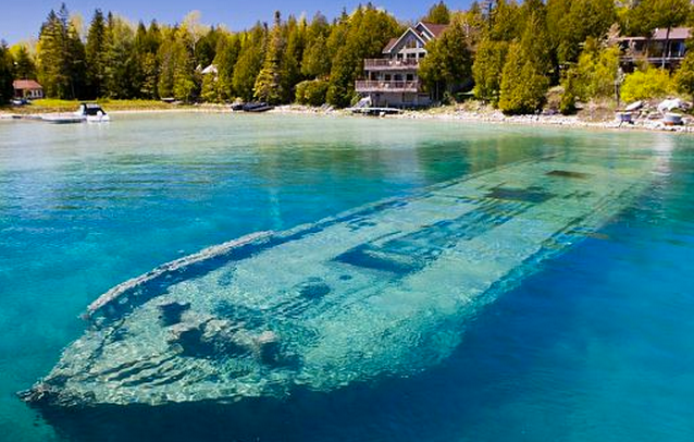 http://www.dailymail.co.uk/news/article-2275055/World-s-beautiful-shipwreck-Haunting-hull-Sweepstakes-lies-just-TWENTY-FEET-clear-blue-water-Ontario-lake-sank-1885.html#axzz2K52CUvPB