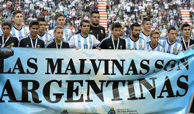 http://www.dailymail.co.uk/news/article-2651961/Argentina-players-pose-banner-proclaiming-The-Falklands-Argentine-World-Cup-warm-match.html