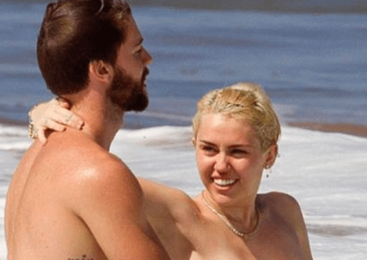 http://www.dailymail.co.uk/tvshowbiz/article-2925741/Miley-Cyrus-goes-topless-frolics-ocean-beau-Patrick-Schwarzenegger.html