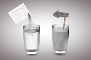 MAAX Detox stiring into glass of water