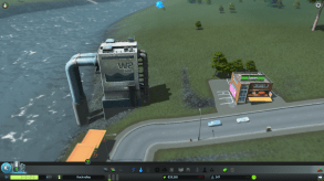 One thing I really like about city simulations is the ability to get down to street level and enjoy the fruits of my labor. Cities: Skylines is no exception. Here is my water pumping plant and a small commercial building. The detail is nice, even if the placement of the handicapped spaces isn't near enough to a door to meet code. :P