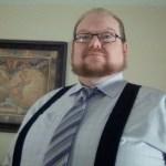 Matt wearing light purple shirt, matching tie, and suspenders