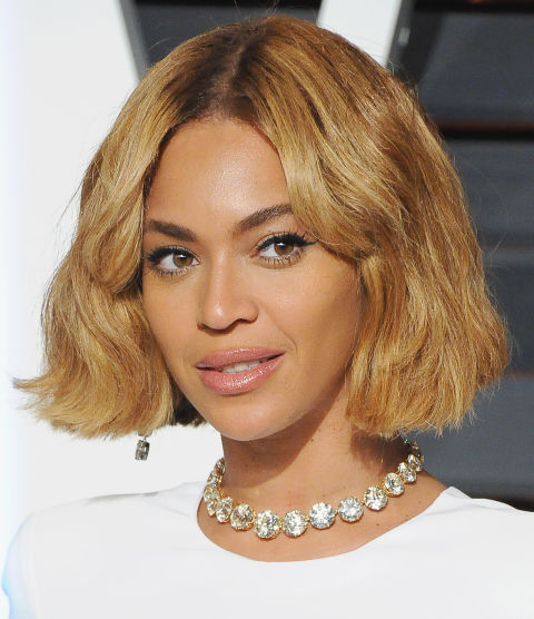 One of our favorite Bey looks yet. The blunt ends and golden highlightsgive this bob a cool-girl flair.