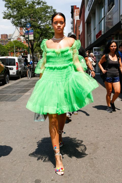 Yet another green statement from RiRi, this time around she lit up Greenwich Village wearing a filmy green babydoll dress that's giving us major Tinker Bell vibes. Paired with strappy rainbow pom pom sandals, she totally pulls it off.