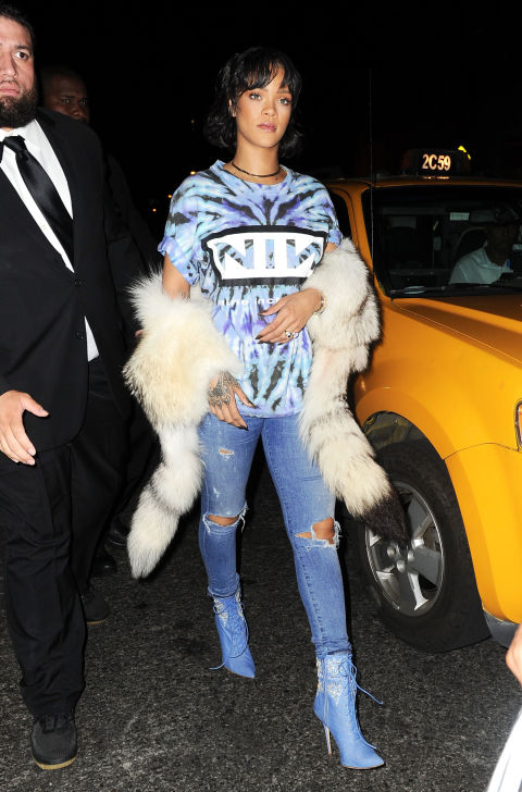 While clubbing with everyone's- boo-boo-but-may-her's Leonardo DiCaprio, RiRi payed homage to Nine Inch Nails in a tie-dye T-shirt with the band's logo, distressed denim, a fur stole, and embellished denim boots from her Manolo Blahnik collab.