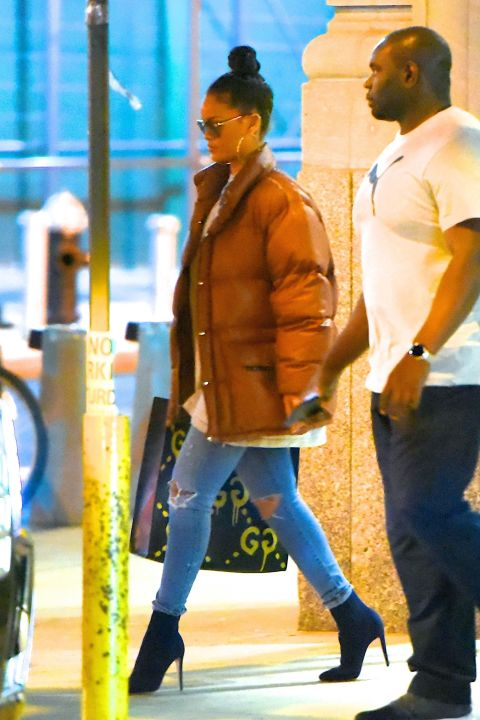 Because no one is more ready for fall than RiRi, she returned to NYC after 31 stops on the European leg of her ANTI world tour wearing a snug brown puffer coat, T-shirt, distressed skinny jeans, and boots.