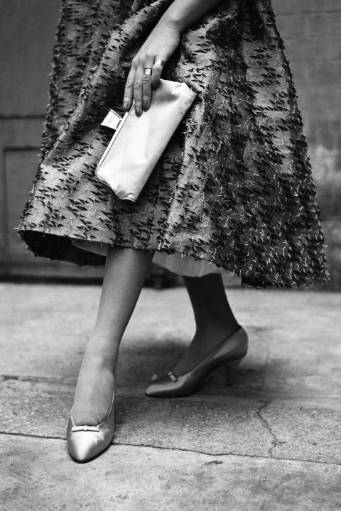 Later into the '50s, things became very demure. Feminine pumps with delicate details take over as the shoe to wear.