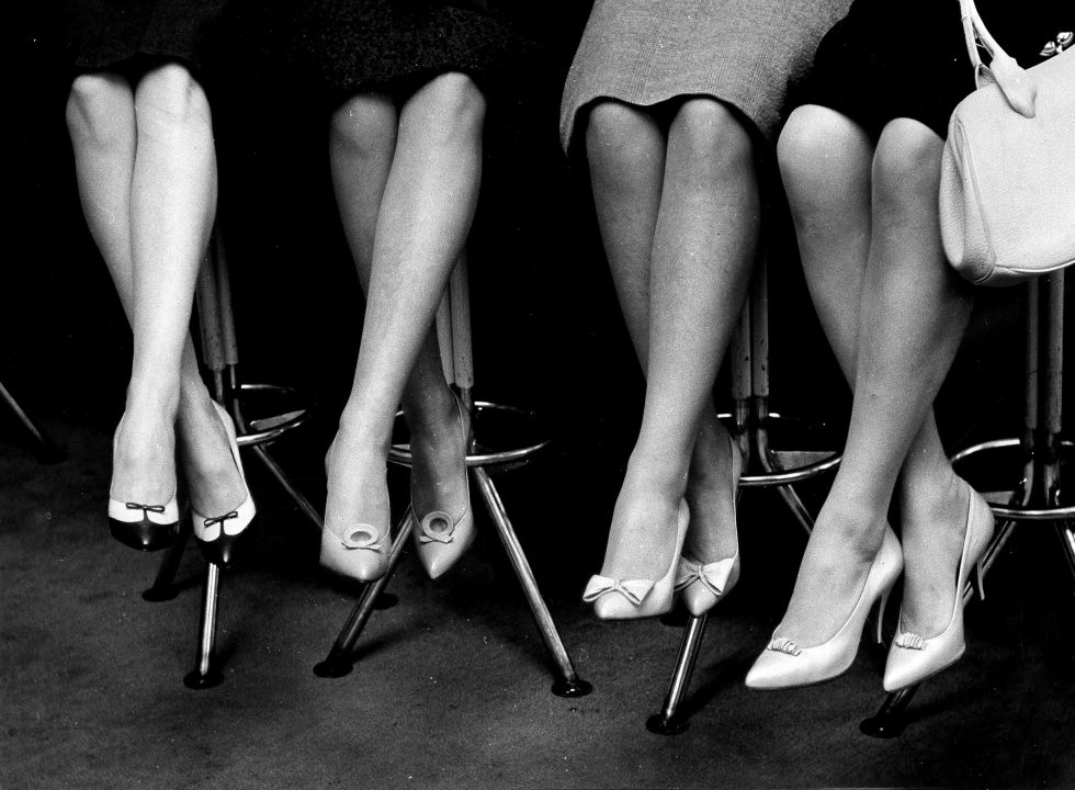 Just imagine all these women sitting on stools are most likely perched at a soda fountain while a jukebox plays.