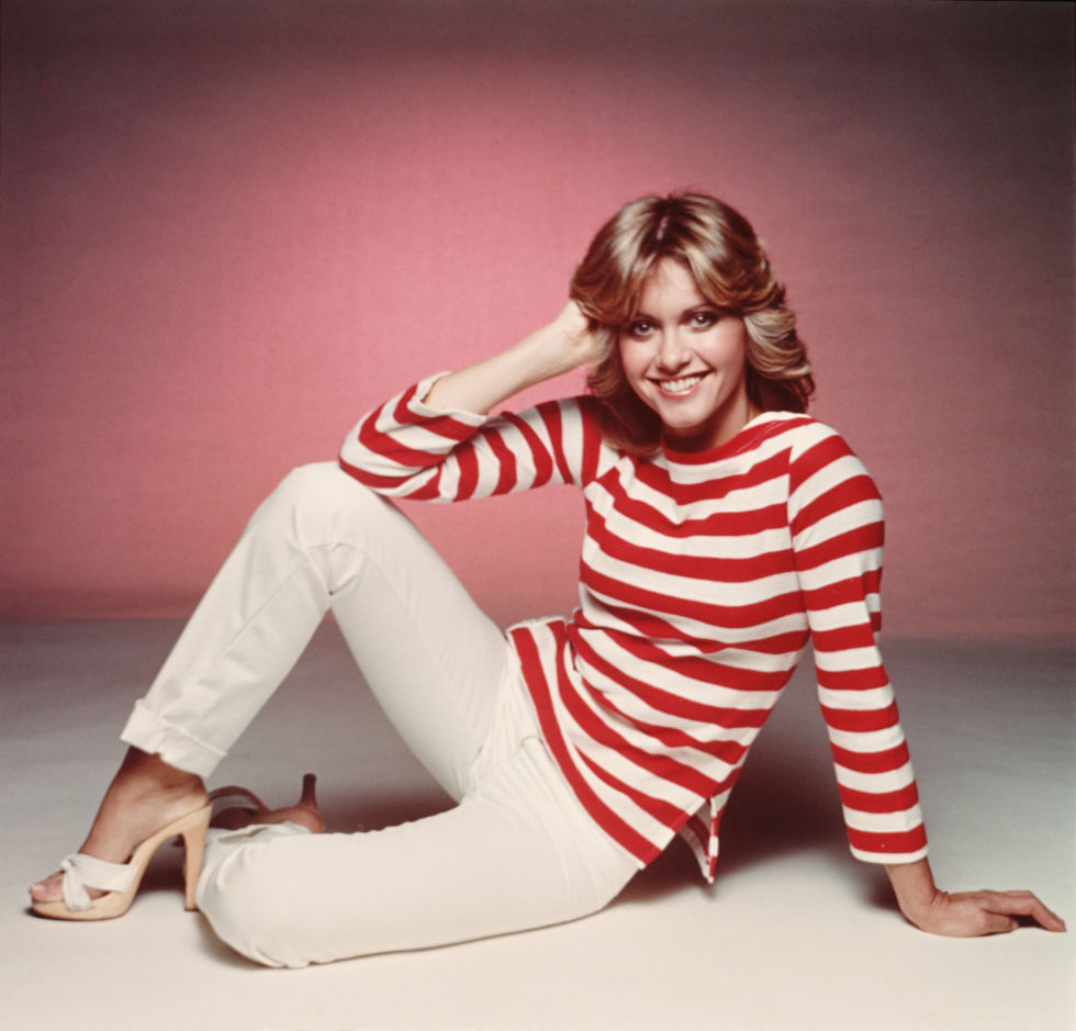 We all know Olivia Newton John loves her wooden-soled slides.