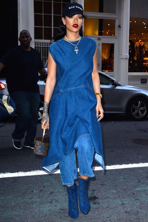 Because RiRi can never pack too much denim into one look, she hit the street in NYC donning an asymmetrical denim dress paired with matching culottes. She accented the look with a baseball cap, navy suede boots, and a Louis Vuitton handle bag.