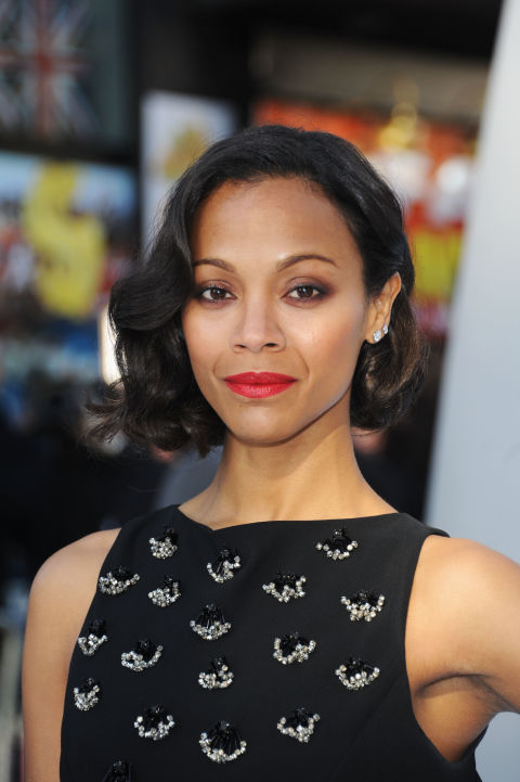 Saldana takes a vacation from her signature long locks with an elegant asymmetrical cut and a red lip.