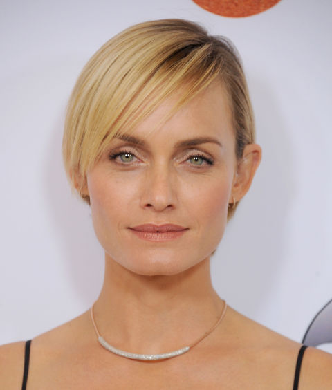 One of the sleekest short cuts ever? Here, the supermodel shows us what it looks like when you ask your stylist to take your bob up an inch, cut slightly cropped side-swept bangs, andapply a super-conditioning hairmask.