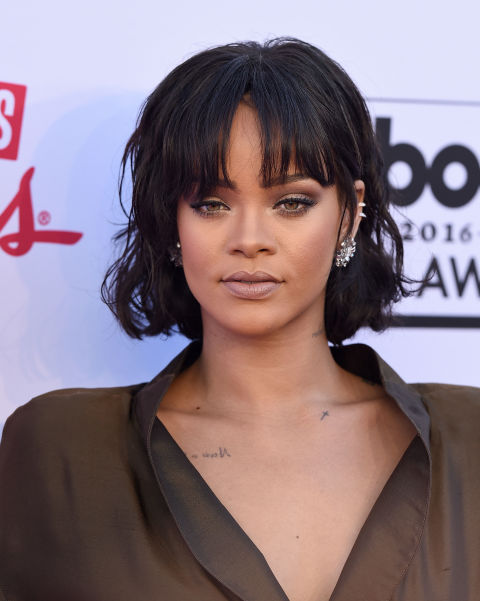The bold RiRi take on the bob involves midnight black strands and thick, in-your-face bangs.