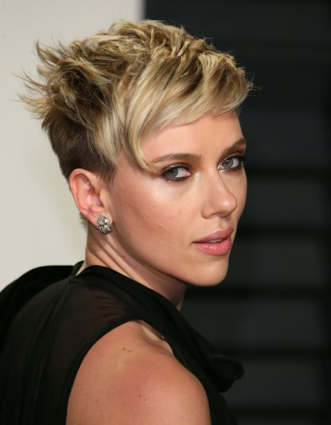 The new cool girl pixie cut is shorn on the sides with thick bangs at the front, and a mixture of dark and light tones.