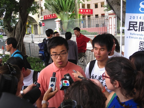 The referendum organizers met journalists yesterday outside the gov't headquarters. Pictured, Scott Chiang and Sulu Sou