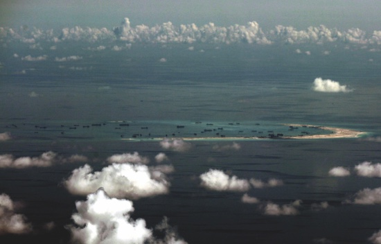 In this May 11 file photo, an aerial image taken through a glass window of a military plane shows China's alleged on-going reclamation of Mischief Reef in the Spratly Islands in the South China Sea