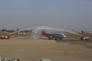 A Hong Kong Airlines' aircraft is welcomed by a traditional water salute in Phnom Penh