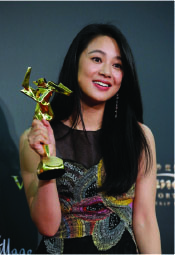 Chinese actress Zhou Yun poses after winning the Best Supporting Actress