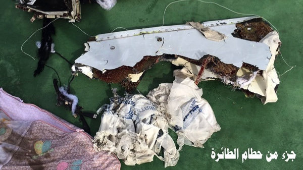 """This picture posted Saturday, May 21, 2016, on the official Facebook page of the Egyptian Armed Forces spokesman shows part of the wreckage from EgyptAir flight 804. Search crews found floating human remains, luggage and seats from the doomed EgyptAir jetliner Friday but face a potentially more complex task in locating bigger pieces of wreckage and the black boxes vital to determining why the plane plunged into the Mediterranean. Arabic reads: """" Part of plane wreckage"""".  (Egyptian Armed Forces Facebook via AP)"""
