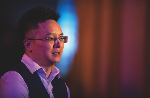The little known Chinese businessman Recon Group CEO Xia Jiantong speaks during an interview about buying Aston Villa