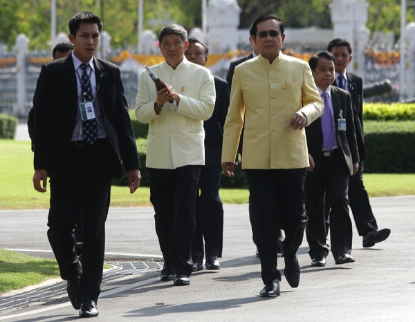 Thai Prime Minister Prayut Chan-o-cha (right), arrives at Government House before a cabinet meeting in Bangkok