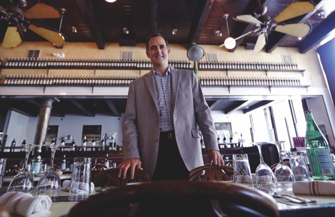 Jeff Gates, who co-owns eight restaurants in the Boston area, poses at his Gaslight restaurant in the South End neighborhood, Tuesday, Sept. 20, 2016, in Boston. Gates, who personally answers his restaurants' online reviews, estimates he's replied to about 4,000 patrons since the online review website Yelp got started. (AP Photo/Charles Krupa)