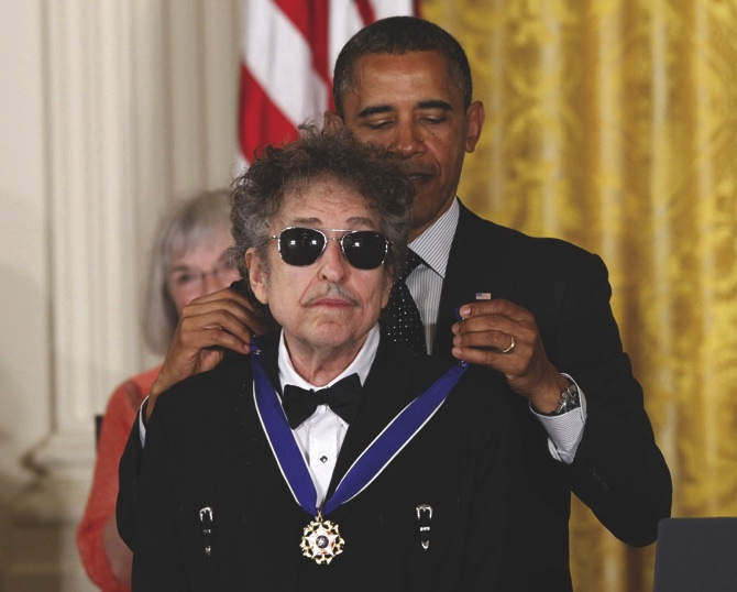 FILE - In this May 29, 2012, file photo, President Barack Obama presents rock legend Bob Dylan with a Medal of Freedom during a ceremony at the White House in Washington. Dylan won the 2016 Nobel Prize in literature, announced Thursday, Oct. 13, 2016. (AP Photo/Charles Dharapak, File)