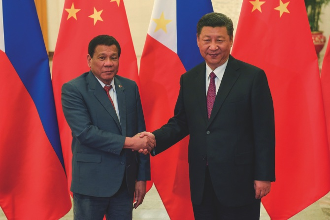 China sidesteps Duterte claim of war threat over sea row