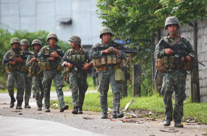 Philippine militants behead 2 Vietnamese hostages held for eight months: Army