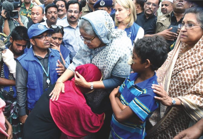 Bangladeshi Prime Minister Sheikh Hasina meets with Rohingya Muslims at Kutupalong refugee camp yesterday