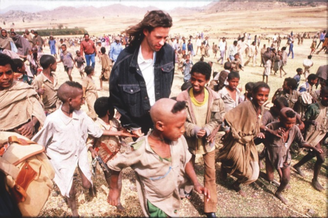 4309bc2053a37 Singer and Live Aid organizer Bob Geldof visits Ethiopia during the 1984  famine