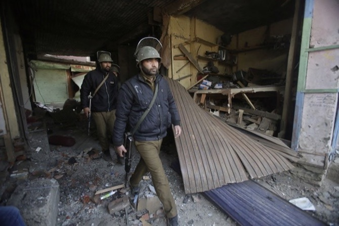 Policemen arrive to inspect the site of explosion in Sopore 55 kilometers north of Srinagar Indian-controlled Kashmir