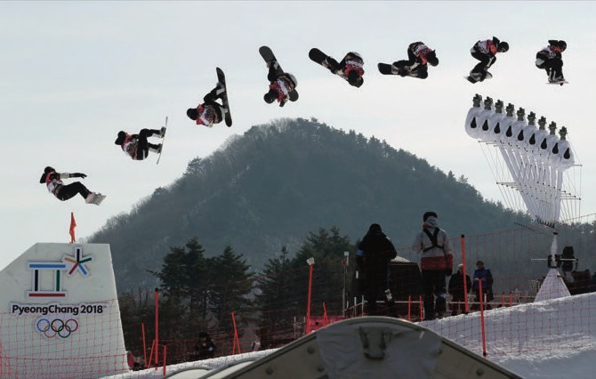 In this multiple exposure image Laurie Blouin of Canada jumps during qualification for the women's Big Air snowboard competition