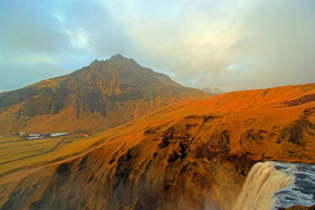 At the top of Skógafoss waterfall