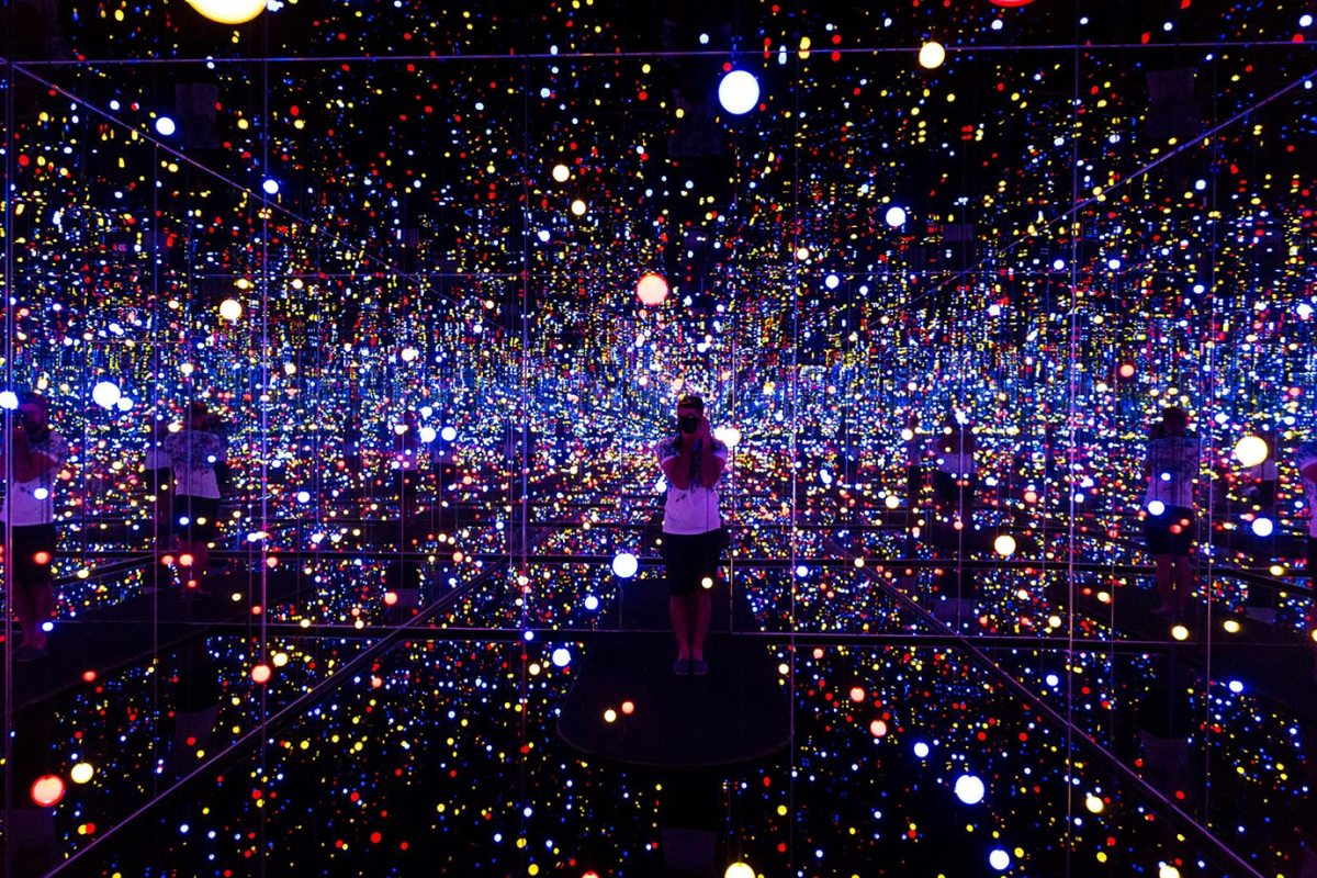 Standing in the middle of a Yayoi Kusama exhibition in Copenhagen, Denmark