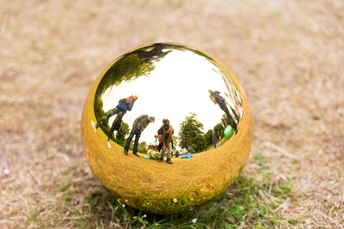 A golden orb at the Sculpture by the Sea festival in Aarhus, Denmark