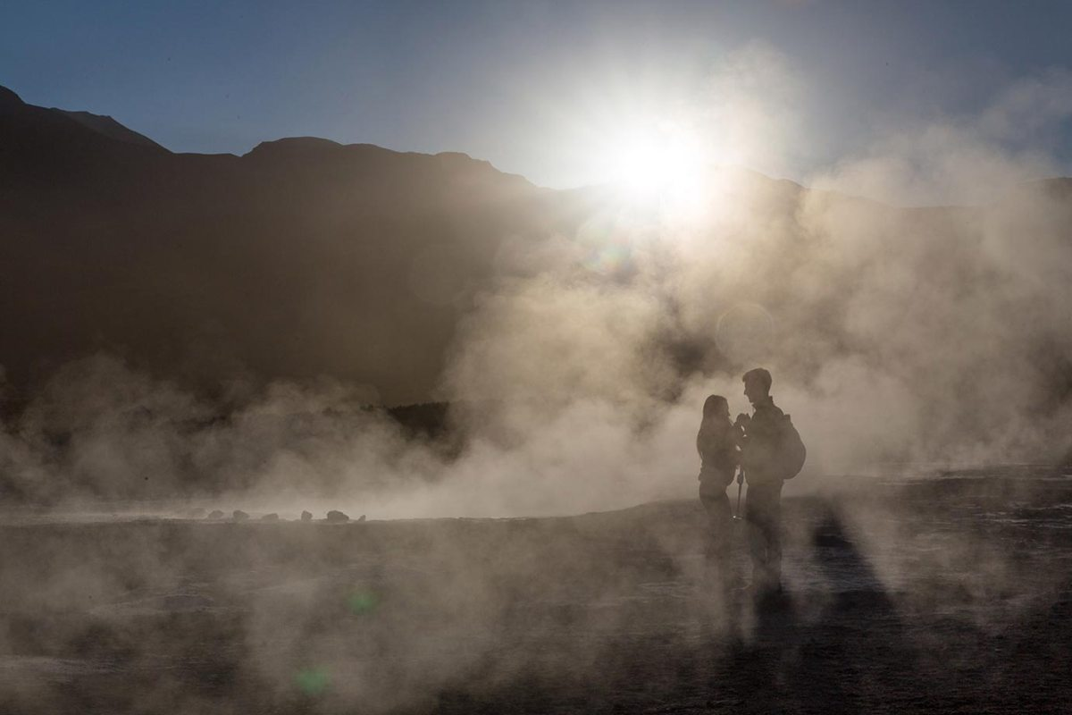 A couple share a moment at the El Tatio geysers in Chile
