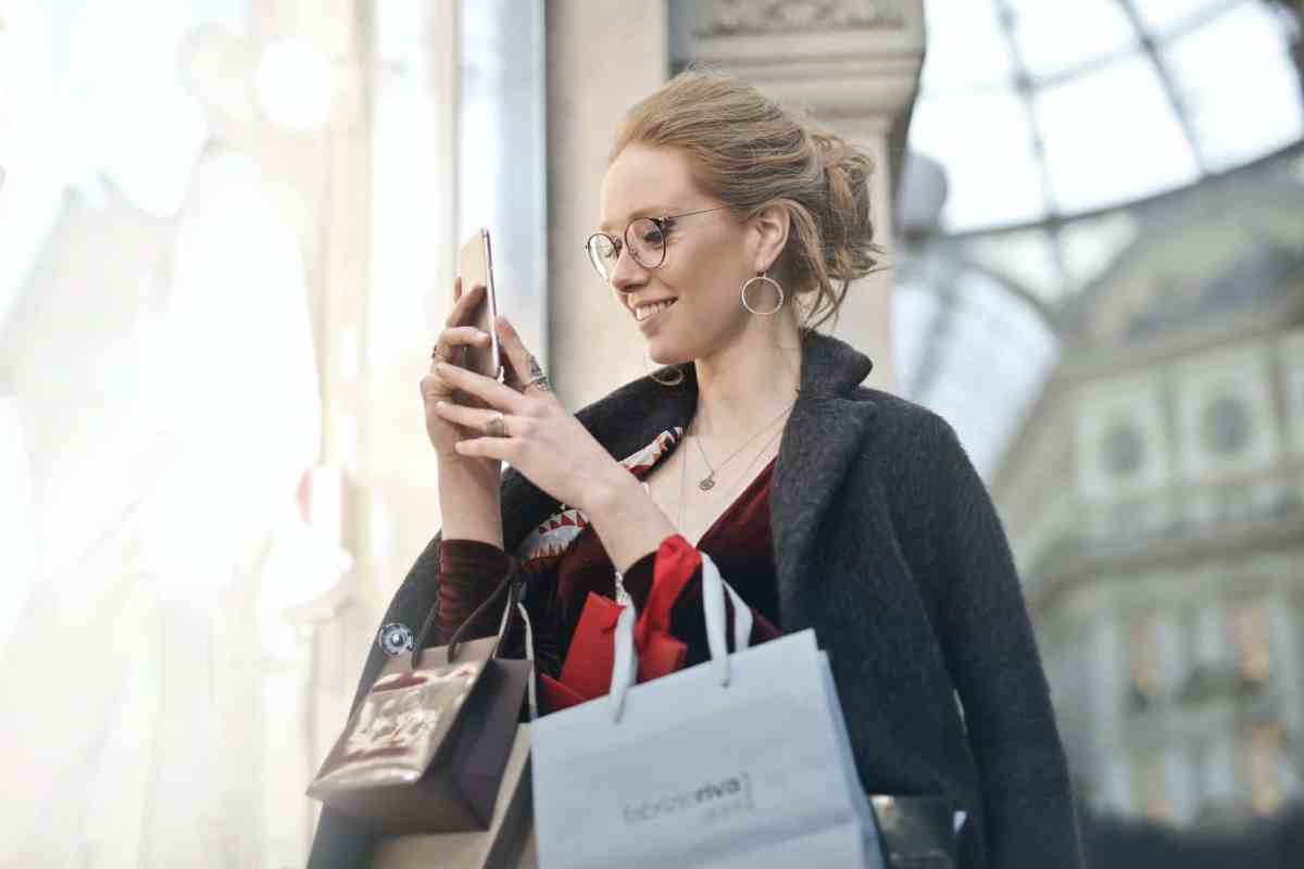 photo of woman holding her phone