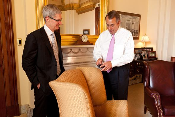 Speaker John Boehner discusses his iPhone with Apple CEO Tim Cook at the U.S. Capitol. May 15, 2012. (Official Photo by Heather Reed)