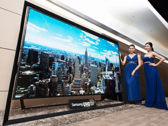 Models pose with a Samsung Electronics' 110-inch UHD TV. Samsung on Monday said a 110-inch UHD TV that has four times the resolution of standard high-definition TVs is going on sales for $152,000 in South Korea. (Photo: Samsung/AP)