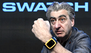 Swatch's delusional CEO Nick Hayek wearing some yellow piece of shit on his wrist