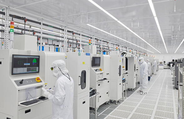 Technicians at Finisar oversee VCSEL production at the Sherman, Texas facility.