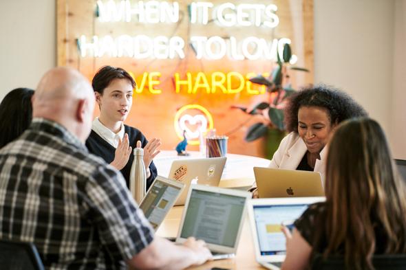 Members of Dream Corps collaborate in the non-profit's Oakland headquarters.