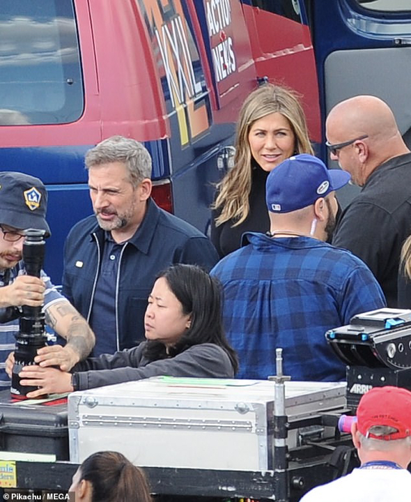Action! Steve Carrell (2-L) and Jennifer Aniston (2-R) reunited Thursday on the downtown Los Angeles set of their upcoming Apple series tentatively titled The Morning Show