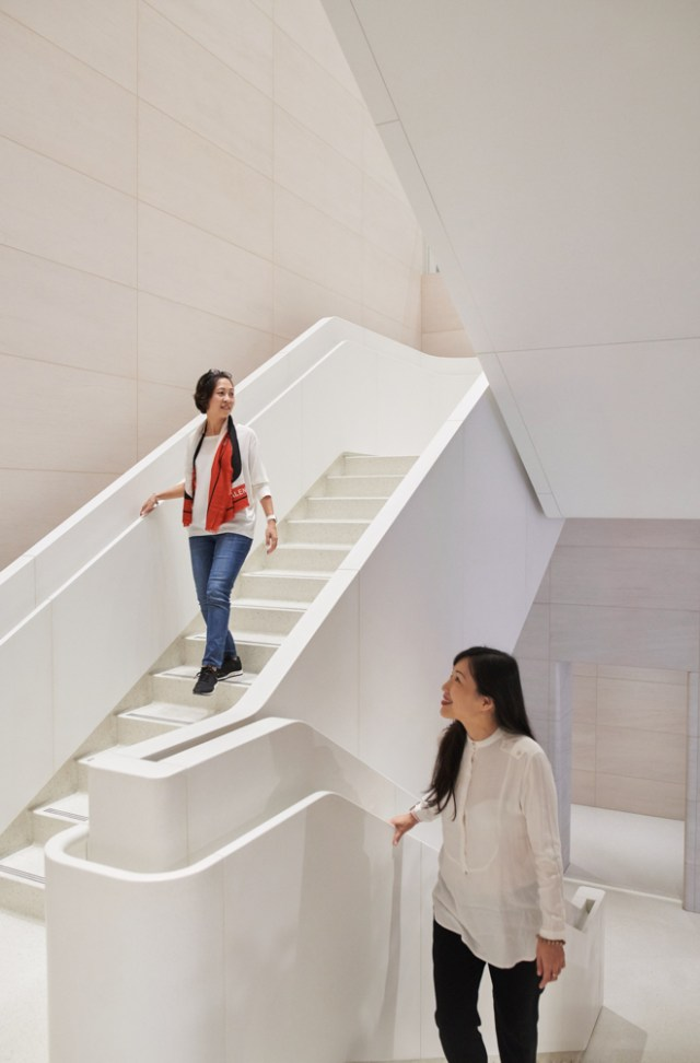 Inside Apple Xinyi A13, two unique, marble composite stairs descend to the lower level.