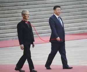 Xi Jinping walks Tim Cook on a leash