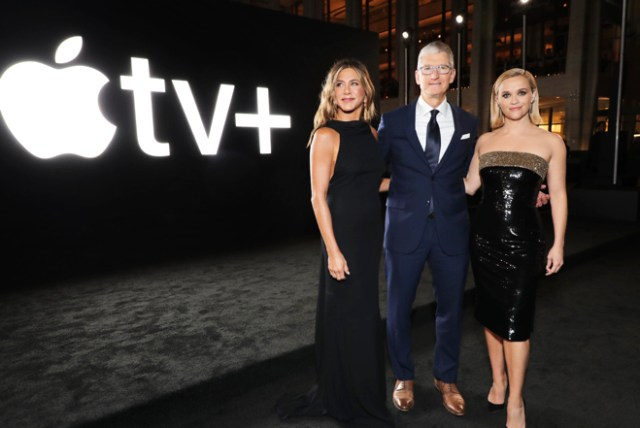 "Jennifer Aniston, Tim Cook and Reese Witherspoon share a moment at the global premiere of ""The Morning Show"" at Josie Robertson Plaza and David Geffen Hall, Lincoln Center for the Performing Arts in New York."