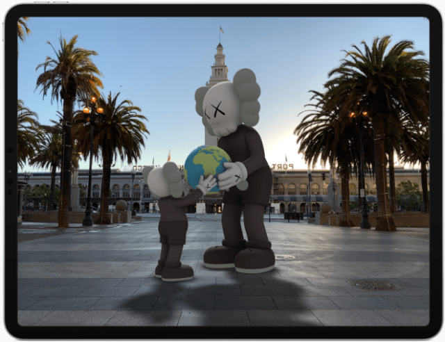ARKit 4 introduces Location Anchors which allow developers to pin their AR experiences to a specific geographic coordinate — such as this KAWS sculpture which can be viewed through the Acute Art app.