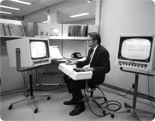 The engineer and researcher William English testing the first computer mouse, a device envisioned by his colleague Douglas Engelbart. It was unveiled in 1968. Credit: SRI International