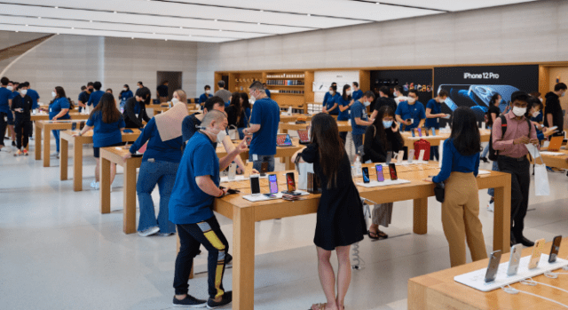Customers arrived at Singapore's Apple Orchard Road to buy the new iPhone 12, iPhone 12 Pro, and iPad Air